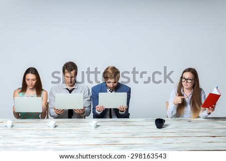 Business team working together at office on light gray background. all working on laptops. boss giving a task, all thinking. copyspace image - stock photo