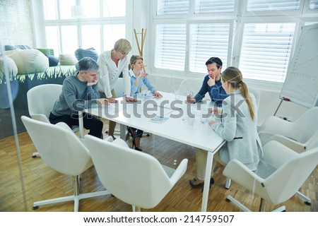 Business team working together in conference room of the office - stock photo