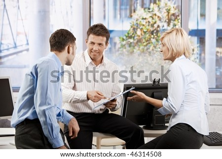 Business team working together in office, people planning, smiling. - stock photo