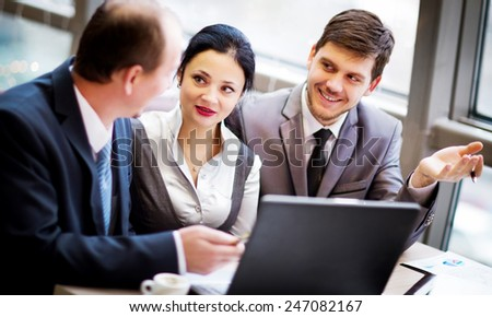 Business team working together to achieve better results - stock photo