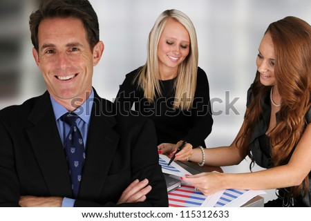 Business Team working while at the office - stock photo