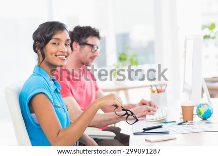 Business team working with computer and digitizer in the office - stock photo