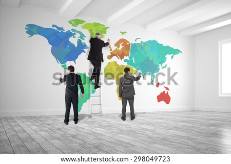 Business team writing against white big room with windows - stock photo