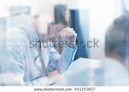 business, teamwork, people and crisis concept - business team sitting sad and solving problem in office - stock photo