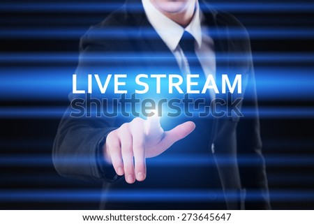 business, technology and internet concept - businessman pressing live stream button on virtual screens - stock photo