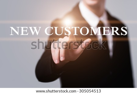 business, technology and internet concept - businessman pressing new customers button on virtual screens - stock photo