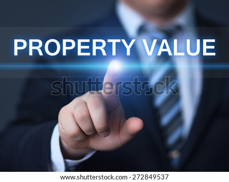 business, technology and internet concept - businessman pressing property value button on virtual screens - stock photo