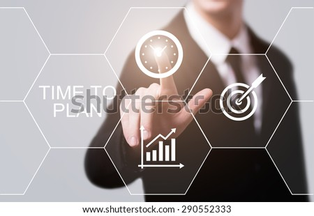 business, technology and internet concept - businessman pressing time to plan button on virtual screens - stock photo