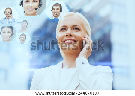 business, technology and people concept - smiling businesswoman with smartphone calling to helpline over office building - stock photo
