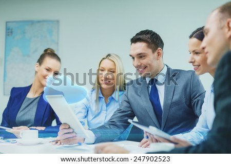 business, technology, cloud computing and people concept - smiling business team with tablet pc computer and virtual cloud projection having discussion in office - stock photo
