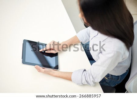 business, technology, communication and people concept - close up of woman with tablet pc computer at office or home - stock photo