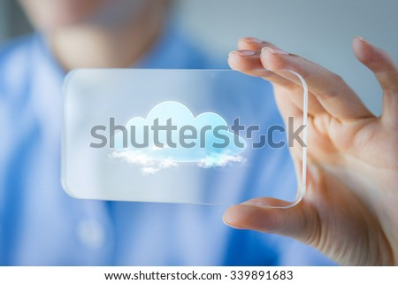 business, technology, computing and people concept - close up of woman hand holding and showing transparent smartphone with cloud icon on screen - stock photo