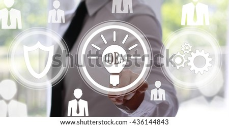 Business, technology concept - businesswoman pressing button with bulb on virtual screens. Shield, gear. Ideas in business. Cyber idea. Business community, the staff. Innovation in business. - stock photo