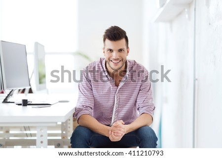 business, technology, education and people concept - happy young creative man or student with computer at office - stock photo