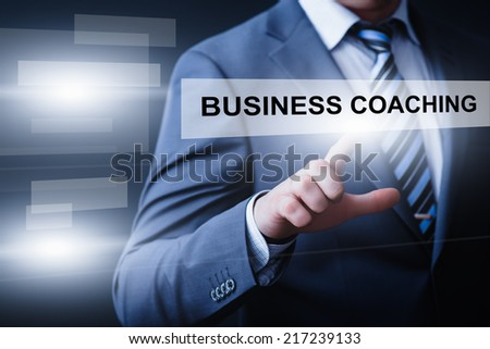 business, technology, internet and networking concept - businessman pressing business coaching button on virtual screens - stock photo