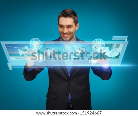 business, technology, internet and networking concept - businessman pressing buttons on virtual screen - stock photo
