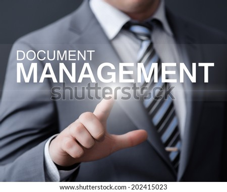 business, technology, internet and networking concept - businessman pressing document management button on virtual screens  - stock photo