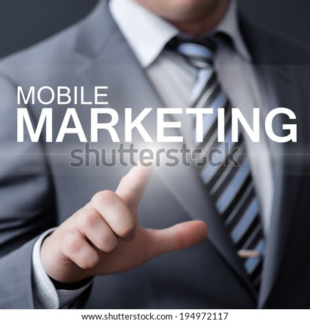 business, technology, internet and networking concept - businessman pressing mobile marketing button on virtual screens - stock photo