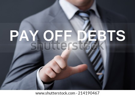 business, technology, internet and networking concept - businessman pressing pay off debts button on virtual screens - stock photo