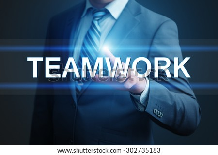business, technology, internet and networking concept - businessman pressing teamwork button on virtual screens - stock photo