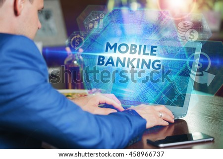 Business, Technology, Internet and networking concept. Young businessman working on his laptop of the future, working with the virtual screen hologram. The inscription on the screen: mobile banking. - stock photo
