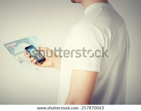 business, technology, internet and news concept - man with smartphone reading news - stock photo