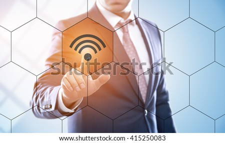 business, technology, internet and virtual reality concept - businessman pressing wi-fi button on virtual screens with hexagons and transparent honeycomb - stock photo