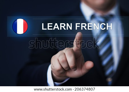 Business, Technology, Internet, Learning and Language school concept - businessman pressing learn French button with flag icon on virtual screens - stock photo