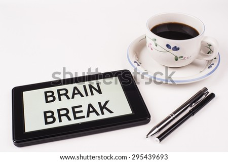 Business Term / Phrase on Tablet PC with a cup of coffee and pens on a White Background - Black Word(s) on a white background - Brain Break - stock photo