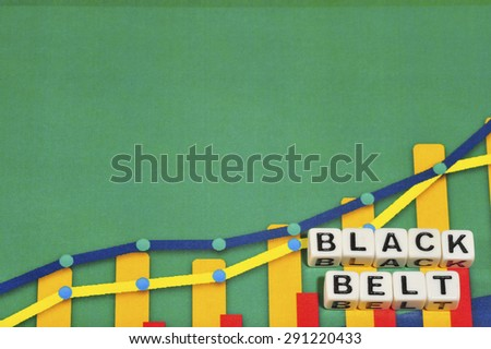 Business Term with Climbing Chart / Graph - Black Belt - stock photo