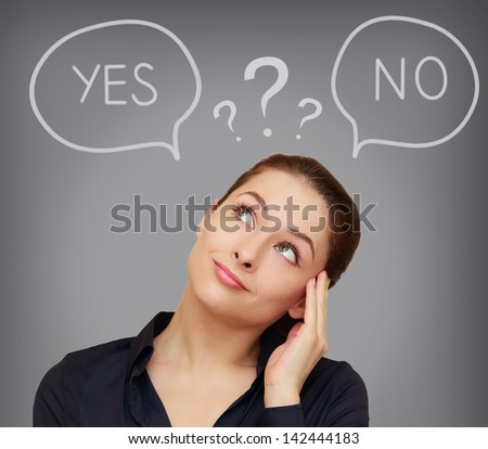 Business thinking woman with yes or on in speech bubble on grey background - stock photo