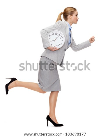 business, time and education concept - calm young businesswoman with clock running - stock photo