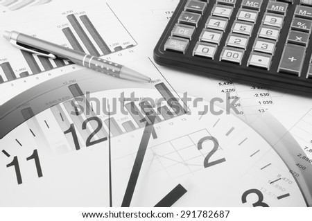 Business time concept, calculator on financial documents and clock - stock photo