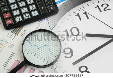 Business time concept with magnifying glass, calculator and financial documents, collage with clock - stock photo