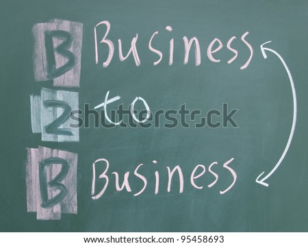 business to business sign written with chalk on blackboard - stock photo