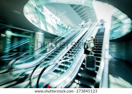 Business Travel, Airport, Escalator. - stock photo