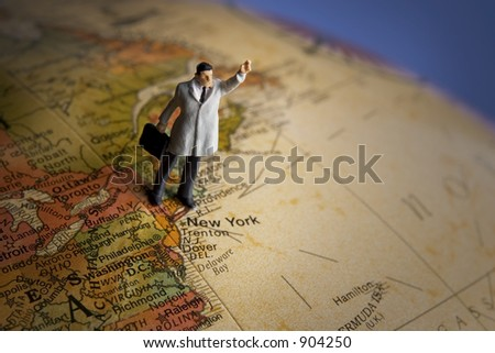 Business travel figure on globe highlighting New York - stock photo