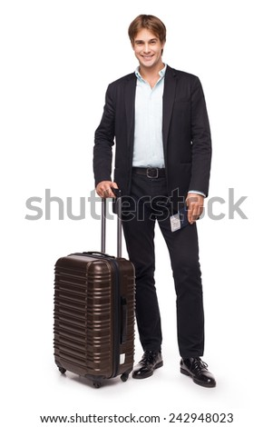 Business traveler smiling and standing with his luggage, isolated on white background - stock photo