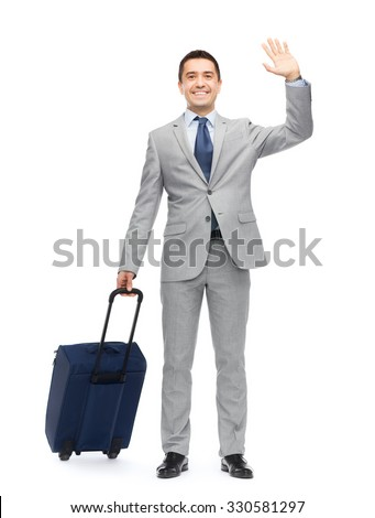 business trip, traveling, luggage, gesture and people concept - happy businessman in suit with travel bag waving hand - stock photo