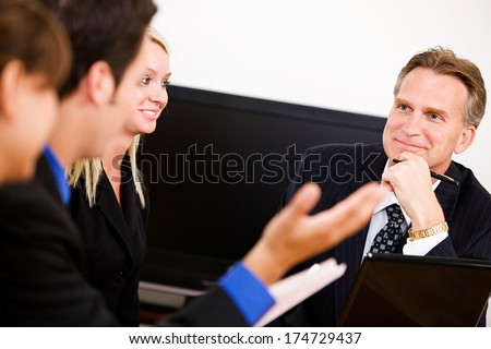 Business: Trying to Explain Problem to Manager - stock photo