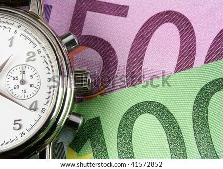 Business watch and European Union currency as a background - stock photo