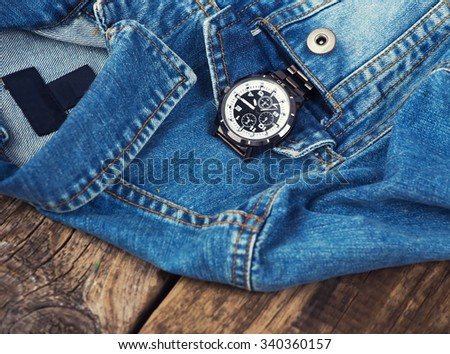 business watch inside pocket jeans. - stock photo