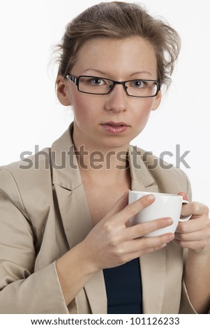 Business woman allows herself a cup of coffee - stock photo