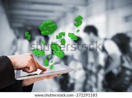 Business woman are making money online by using digital tablet on skywalk - stock photo