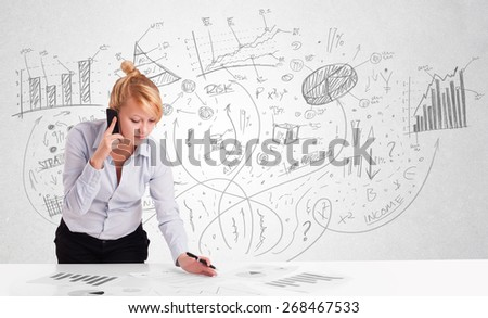 Business woman at desk with hand drawn charts at the background - stock photo