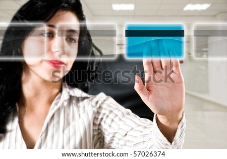 Business woman at office choosing credit card for online payment - stock photo