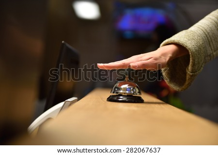business woman at the reception of a hotel checking in - stock photo
