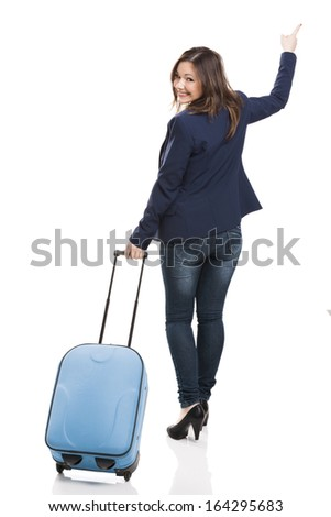 Business woman carrying a suitcase and looking back, isolated over white background - stock photo