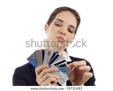Business woman choosing which credit card to pay with, isolated over white - stock photo