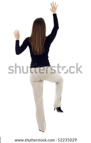 Business woman climbing a wall - determination, isolated over a white background - stock photo